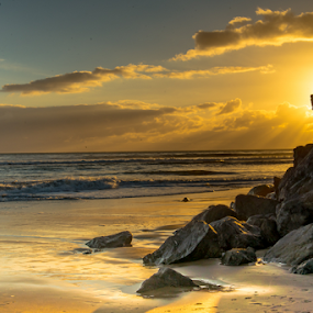 Lighthouse beach sunset by Kathy Dee - Landscapes Sunsets & Sunrises ( clouds, water, california, ocean, seascape, beach, yellow, landscape, sky, santa, cruz, oceanscape, sunset, gold, rocks, golden, foam,  )
