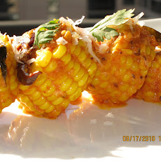 Corn in a spicy sauce of yoghurt, curry leaves, grated coconut and toasted red chillies