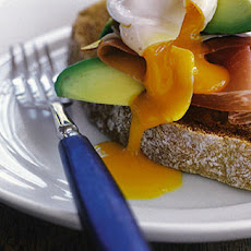 Avocado bruschetta with Parma ham and poached egg