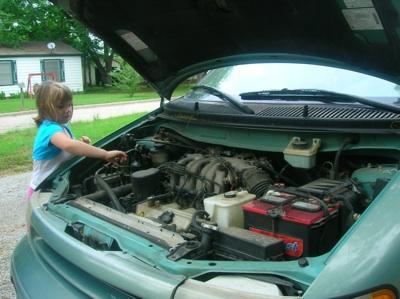ains fixing car.jpg