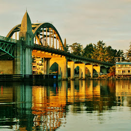 by Lori Pagel - Buildings & Architecture Bridges & Suspended Structures ( water, calm, oregon, reflection, green, coastal, coast, mirror, florence, turquoise, drawbridge, sunset, wet, bridge, gold, evening, golden, river )