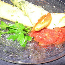 Herbed Crepes With Ricotta, Green Peppers and Tomato Sauce