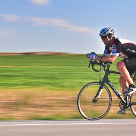 The race is on! by Kati Garner - Transportation Bicycles ( rider, racing, bicycle race, tires, helmet, bicyclist, spokes, bicycle )