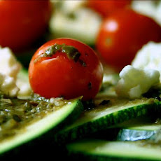 Zucchini and Grape Tomatoes in Pesto With Feta