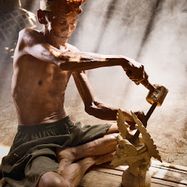 Chiselling Destiny by San Spirit - People Portraits of Men ( tuck shop, naked man, poverty, craftsman, sunlight, carver )
