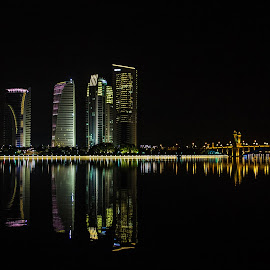 reflection by Sivani Siva - Buildings & Architecture Office Buildings & Hotels ( water, lights, reflection, putrajaya, buildings, malaysia, night, architecture, bridge )