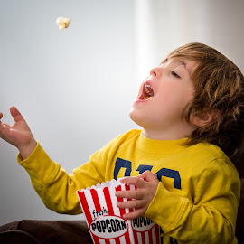 Popcorn by Mike DeMicco - Babies & Children Child Portraits ( popcorn, child, silly, happy, funny, movie, adorable, fun, cute, catching, boy, kid )