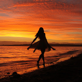 Dance like no one's watching by Gee Lyon - Landscapes Sunsets & Sunrises ( girl, silhouette, sunrise, beach, dance, Selfie, self shot, portrait, self portrait )