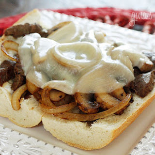 Steak and Cheese Sandwiches with Onions and Mushrooms