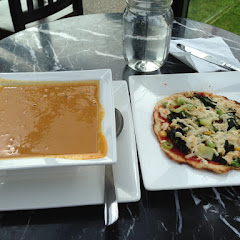 Bowl of Pumpkin and Black Bean Soup and Flatbread with Vegetables and Dayia Cheese.