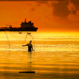 Sunset Catch by Lawrence Chung - Landscapes Sunsets & Sunrises ( beach, boat, fisherman, people )