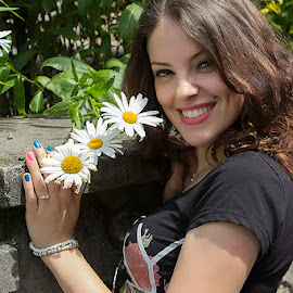 Emma by Alunita Munteanu - People Street & Candids ( woman, instantaneous, snapshot, street, alunita munteanu, daisies, three, happiness, flowers, smile, young, portrait )