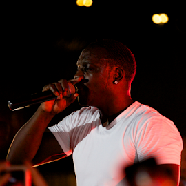 Black singer Akon in T-shirt with microphone by Nick Dale - People Musicians & Entertainers ( concert, iphones, t-shirt, white, singer, turkey, bodrum, stage, black, akon )