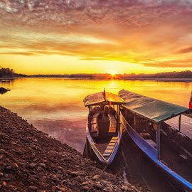Dawn on the Tambopata River by Patricia Solano - Landscapes Travel ( peru, boats, sunrise, tambopata, river, water, device, transportation )