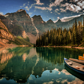 Moraine Lake by Joseph Law - Landscapes Waterscapes ( clouds, national park, blue sky, bushes, boats, rocky mountains, reflections, trees, banff, moraine lake )