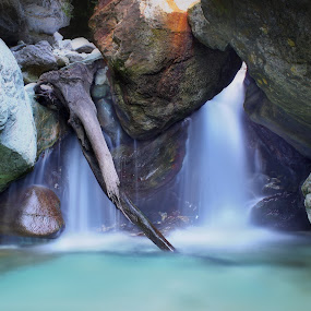 Balanced Rocks by Paolo Lazzarotti - Nature Up Close Water ( turquoise water, backlit, mountain, long exposure, water fall, lonely trunk, big rocks,  )