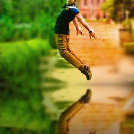 Jump of Joy by Rajesh Kumar Das - People Portraits of Men ( reflection, jumping, joy, happiness, men, nikon, people, photography, portrait, jump )