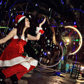 Santa Girl with Light by Vincent Lim - City,  Street & Park  Amusement Parks ( lighting, santa, moods, mood, flare, mood lighting, bokeh, light )