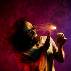 light my fire by Petros Sofikitis - People Portraits of Men ( wind, glasses, colors, sticks, tshirt, fire, man )