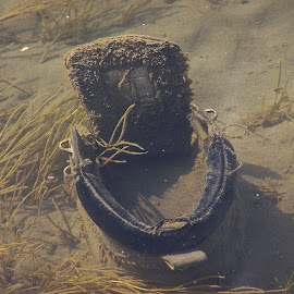 Boot in the River. by Clyde Cornfield - Nature Up Close Water ( boot under water, artistic, object )