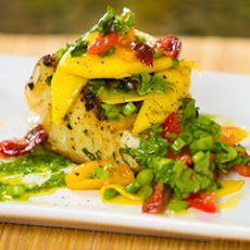 Grilled Sea Bass With Spinach And Pine Nut Pesto And Mango Cherry Tomato Salad