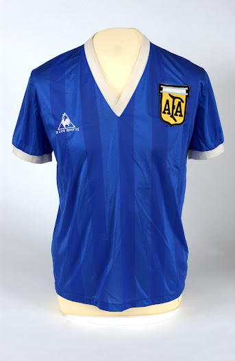 """""""When I look at this shirt I don't think of the 'hand of god' or the second goal against England; I think of Maradona raised up on the shoulders of the crowd."""" David Goldblatt, Football Writer"""