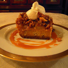 Pumpkin Pudding with Caramel, Apples, and Pecans, topped with Frangelico Cream