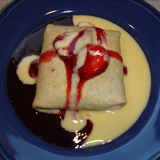 Three Berry Crepes with Creme Anglaise and Strawberry Sauce