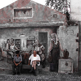 Book Ends by Ian Thompson - City,  Street & Park  Street Scenes ( ironic, tinnura, sardinia, art, mediterranean, street, irony, men, travel, mural, painting, people,  )