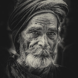 Portrait of working man by Rana Saad - People Street & Candids ( lahore, street life, black and white, portrait, street photography )
