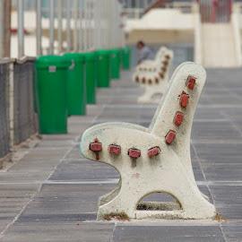 an empty seat by Irvine Eidelman - City,  Street & Park  Street Scenes ( chair, seat, desolate, empty, lonely )