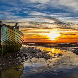 Sunset On a Dry Sea by Paweł Saj - Landscapes Sunsets & Sunrises ( clouds, nature, sunset, boats, yelow, cloud, sea, sunset cloud clouds boat boats sea nature yelow, boat,  )