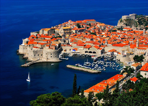 Dubrovnik Fortress by Anton Donev - City,  Street & Park  Historic Districts ( fortress lovrijenac, old, tourist resort, harbor, europe, famous place, beach, coastline, photography, island, city, national landmark, village, color image, no people, dalmatia, travel destinations, travel locations, water, mediterranean sea, middle ages, church, croatia, journey, sea, fort, adriatic sea, architecture and buildings, mediterranean countries, urban scene, dubrovnik, blue, horizontal, castle, town, roman, medieval,  )