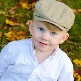 Irish Eyes by Ken Mccartney - Babies & Children Child Portraits ( child, bird, park, blue, fall, irish, smile, leaves, boy, eyes )