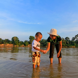 me and Mom by Heru  Nurjati - People Family ( family mom kids paly river sunset summer )