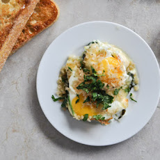 Fontina and Spinach Baked Eggs with Garlic Brown Butter Breadcrumbs