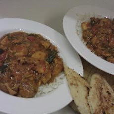 Fruit Chicken Curry With Orange And Tomatoes