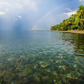 Rainbow from water by Manny Fajutag - Landscapes Waterscapes