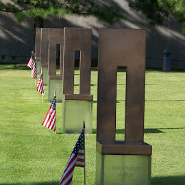 Oklahoma Memorial Chairs In A Row by Melanie Goins - City,  Street & Park  Cemeteries ( flags, oklahoma, chairs, names, rows,  )