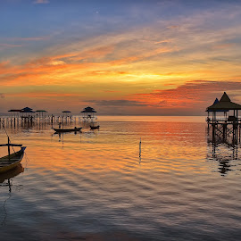 Sunrise at Kenjeran Beach, Surabaya by Kristianus Setyawan - Landscapes Sunsets & Sunrises ( reflection, wooden jetty, skyline, kenjeran beach, waterscape, boats, sunrise scenery, seascape, landscape, surabaya, sunrise reflection, indonesia, landscape photography, skyview, sunrise, sunrise photography, seaview,  )