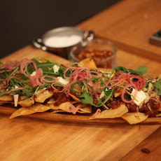 Sweet and Spicy Sausage Ragu Nachos with Pickled Onions