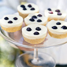 Blueberry Lemon Cakes With Cheesecake Topping