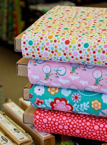 Cute stack of Fancy Free fabric by Riley Blake