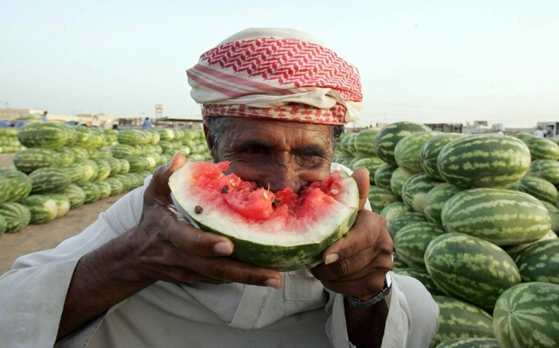 A Saudi man eats watermelon at the bazaar in Dhahran, 400kms east of the capital Riyadh on May 16, 2008. AFP PHOTO/STR (Photo credit should read -/AFP/Getty Images)