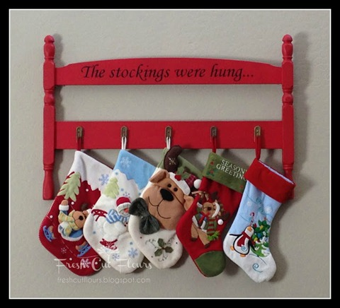 repurposed headboard stocking display