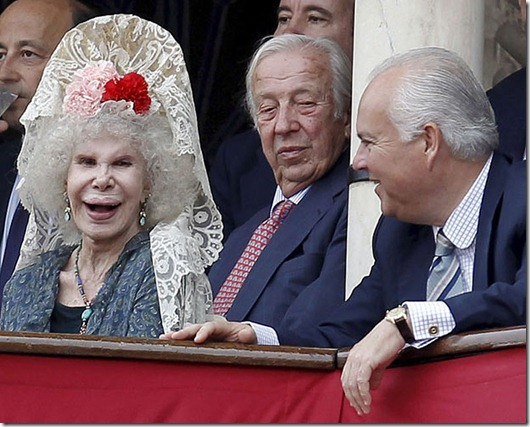 Bullfighting celebrated on the ocassion of the Feria de Abril (April's Fair) at Real Maestranza bullring in Seville...epa02130682 Cayetana Fitz-James Stuart (L), 18th Duchess of Alba, chats with the Director of Ceremonies of the Real Maestranza bullring Alfonso Guajardo-Fajardo (R) as professor of Commercial Law Manuel Olivencia (C) looks on during a bullfighting celebrated on the ocassion of the Feria de Abril (April's Fair) at Real Maestranza bullring in Seville, Andalusia, southern Spain, 24 April 2010. April's Fair, also known as Seville's Fair, is a week long festival where visitors can enjoy food, drink, parades, traditional costumes, bullfighting and flamenco.  EPA/JULIO MUNOZ