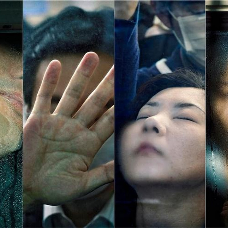 Portraits of Squashed Commuters in Japan by Michael Wolf