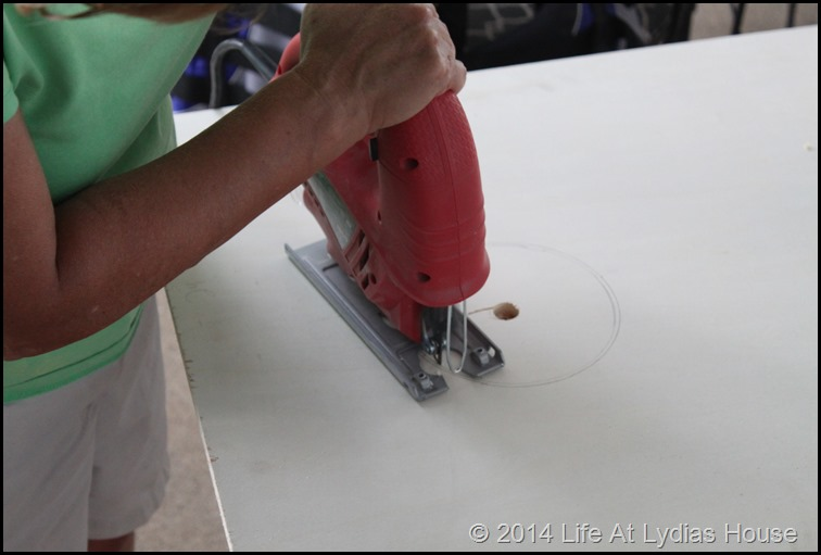 using a jig saw to cut the hole