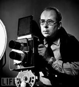 Philippe Halsman poised w. camera