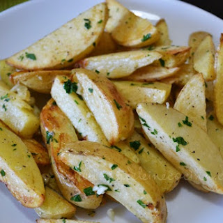 Baked Potato Strips with Garlic and Parsley.